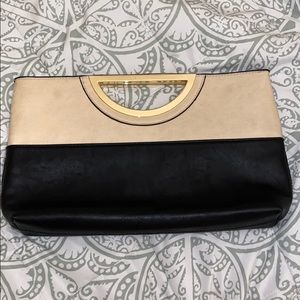Beige and black clutch with gold accents